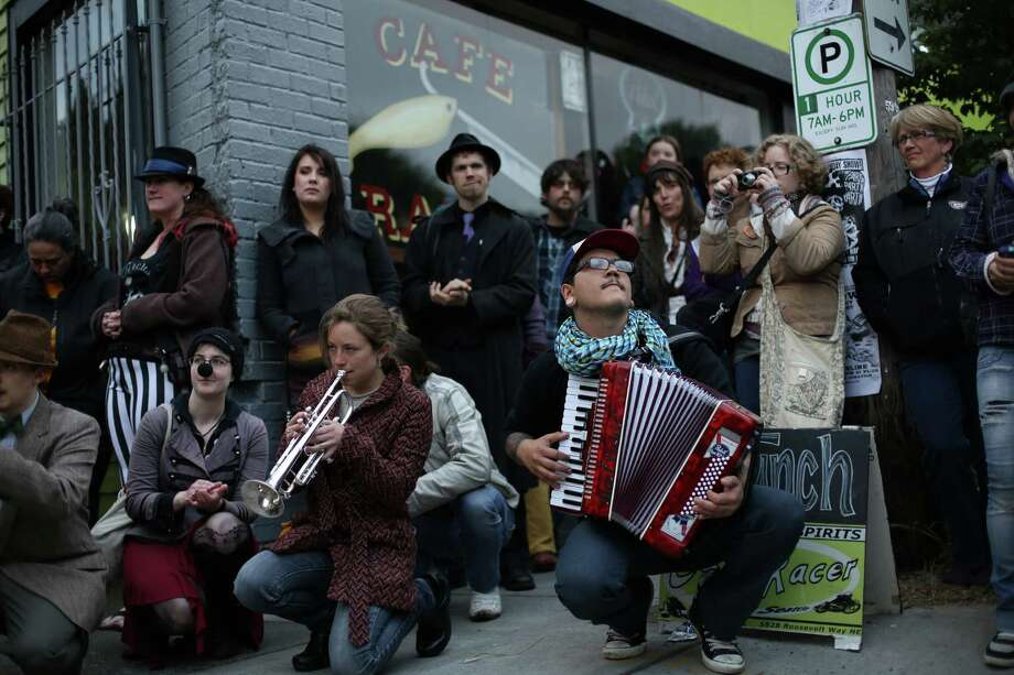 Members of Orkestar Zirkonium perform during a memorial march and concert on Thursday, May 30, 2013, the one year anniversary of the shootings that left four people dead in the popular cafe. Dozens of people marched to music from the band Orkestar Zirkonium from Cafe Racer to nearby Cowen Park. Photo: JOSHUA TRUJILLO, SEATTLEPI.COM / SEATTLEPI.COM