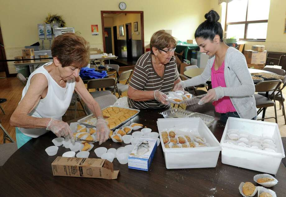 Sophia Severino, left, Christine Pakatar, center, and Christina Dafniotis pack Greek pastries in preparation for St. Basil Greek Festival on Thursday May 30, 2013 in Troy, N.Y. The festival runs Friday from 5-10pm , Saturday 12-10pm and Sunday 12-5pm. (Michael P. Farrell/Times Union) Photo: Michael P. Farrell
