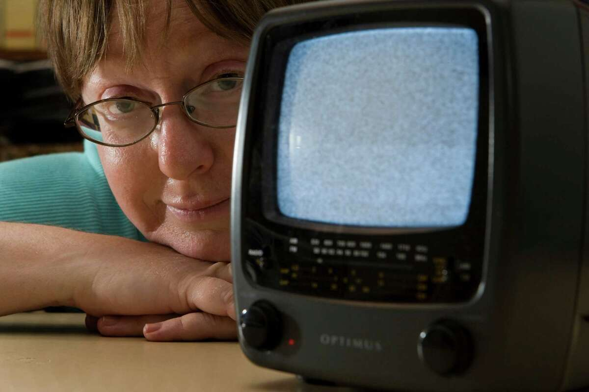 Donna Clanton poses for a portrait with her battery powered analog television. ( Brett Coomer / Chronicle )
