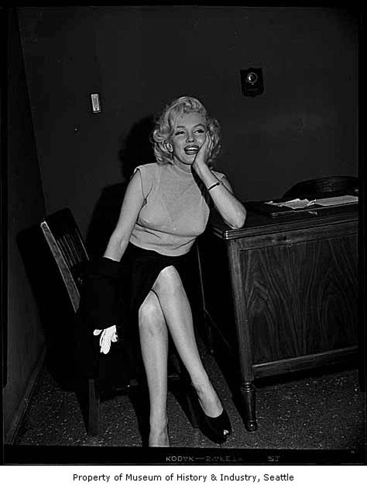 This candid shot of Marilyn Monroe was taken during a visit to the Seattle Post-Intelligencer offices on July 30, 1953. It wasn't published at that time and didn't appear in the P-I until April 2000, upon opening of an exhibit of historic P-I photos at the Museum of History and Industry. Handwritten on sleeve: Monroe, Marilyn; Films.