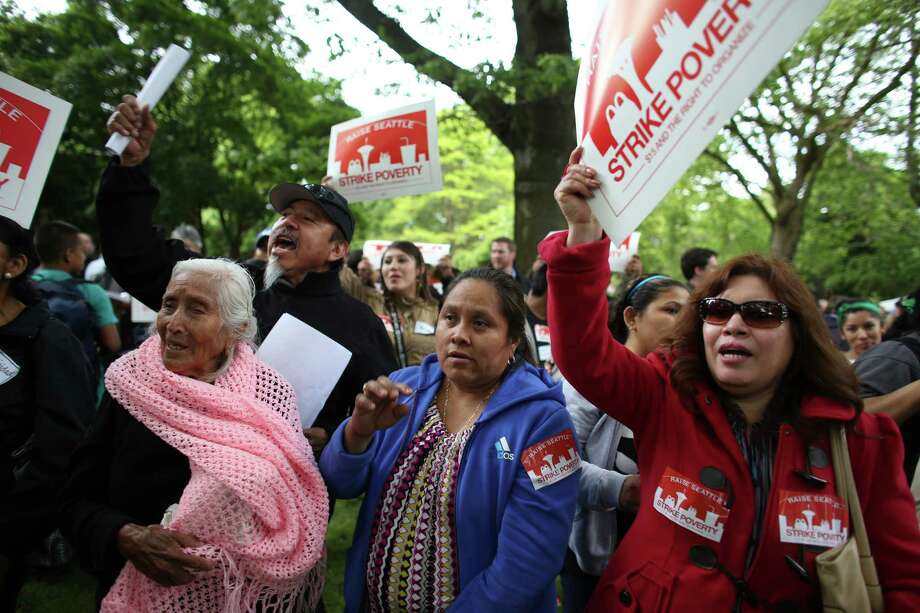 Labor organizers and fast food workers gather for a rally at Denny Park on Thursday, May 30, 2013. The group was asking for higher wages for fast food workers and to allow them to organize without retaliation. Hundreds of people participated in a march after a day of strikes at fast food restaurants around Seattle. Photo: JOSHUA TRUJILLO, SEATTLEPI.COM / SEATTLEPI.COM