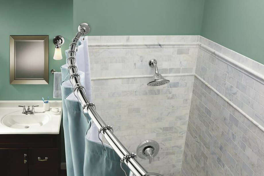 Tension holds the Moen curved shower rod in place. Photo: Courtesy Photo