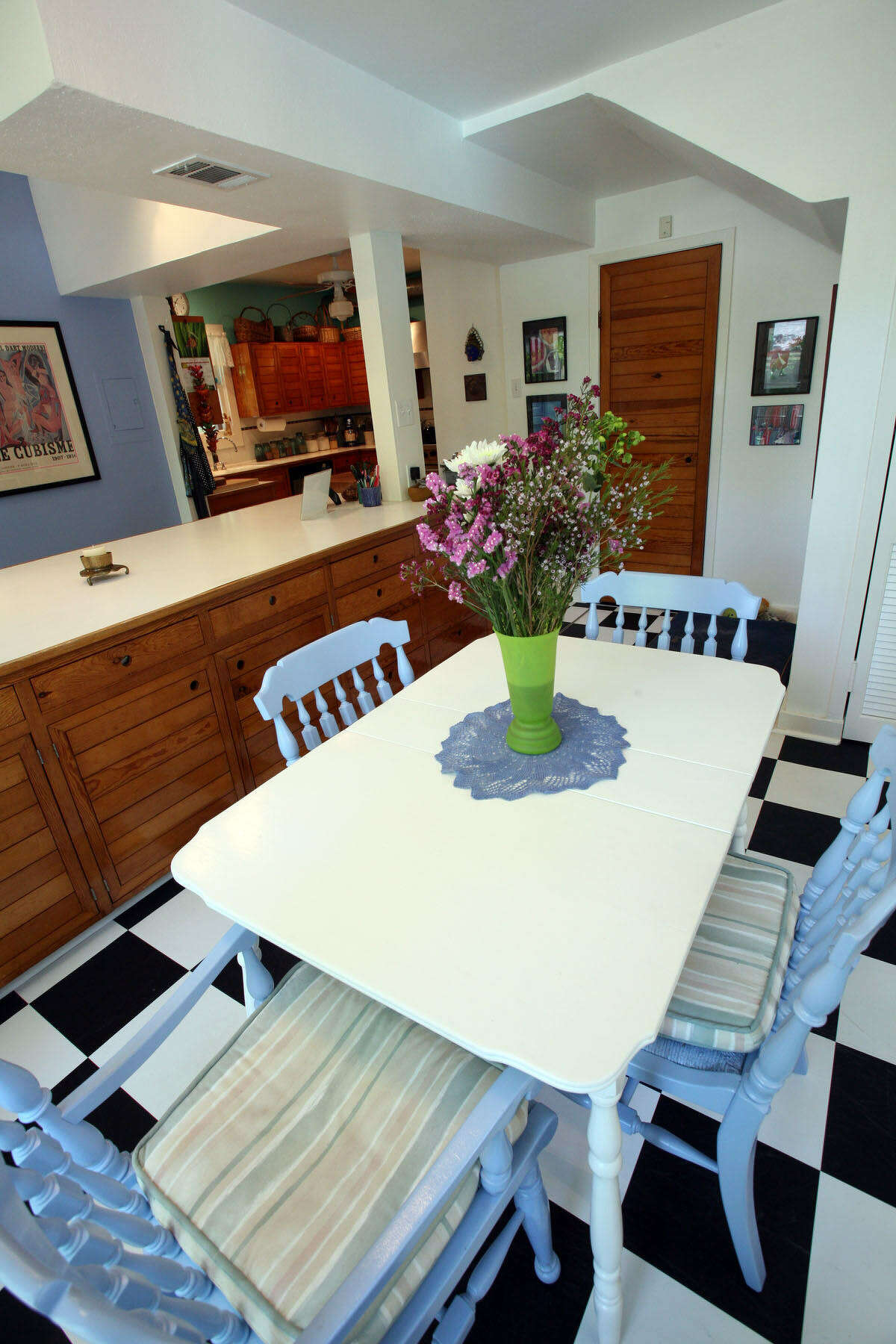 Paint updated maple dining chairs from Jan Peranteau's mother and a table from her sister-in-law.