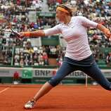 PARIS, FRANCE - MAY 30:  Victoria Azarenka of Belarus plays a backhand in her Women's Singles match against Annika Beck of Germany during day five of the French Open at Roland Garros on May 30, 2013 in Paris, France.  (Photo by Matthew Stockman/Getty Images)  *** BESTPIX ***