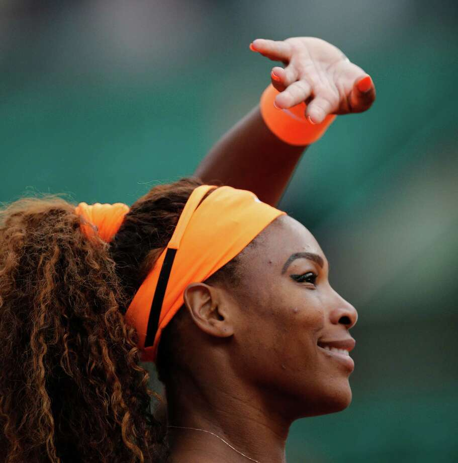 Serena Williams of the U.S. greets spectators after defeating Caroline Garcia of France  in their second round match of the French Open tennis tournament, at Roland Garros stadium in Paris, Wednesday, May 29, 2013. Williams won in two sets 6-1, 6-2. Photo: Christophe Ena, AP / AP