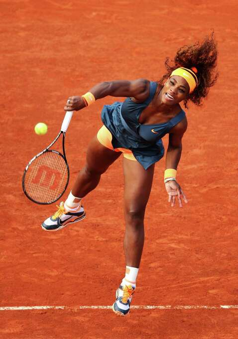 PARIS, FRANCE - MAY 29:  Serena Williams of United of States America serves in her Women's Singles match against against Caroline Garcia of France during day four of the French Open at Roland Garros on May 29, 2013 in Paris, France.  (Photo by Matthew Stockman/Getty Images) *** BESTPIX *** Photo: Matthew Stockman, Getty Images / 2013 Getty Images