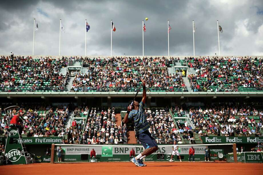 PARIS, FRANCE - MAY 29:  Gael Monfils of France serves in his Men's Singles match against Ernests Gulbis of Latvia during day four of the French Open at Roland Garros on May 29, 2013 in Paris, France.  (Photo by Matthew Stockman/Getty Images) *** BESTPIX *** Photo: Matthew Stockman, Getty Images / 2013 Getty Images
