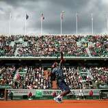 PARIS, FRANCE - MAY 29:  Gael Monfils of France serves in his Men's Singles match against Ernests Gulbis of Latvia during day four of the French Open at Roland Garros on May 29, 2013 in Paris, France.  (Photo by Matthew Stockman/Getty Images) *** BESTPIX ***