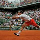 Spain's Rafael Nadal returns against Germany's Daniel Brands in their first round match of the French Open tennis tournament, at Roland Garros stadium in Paris, Monday, May 27, 2013.