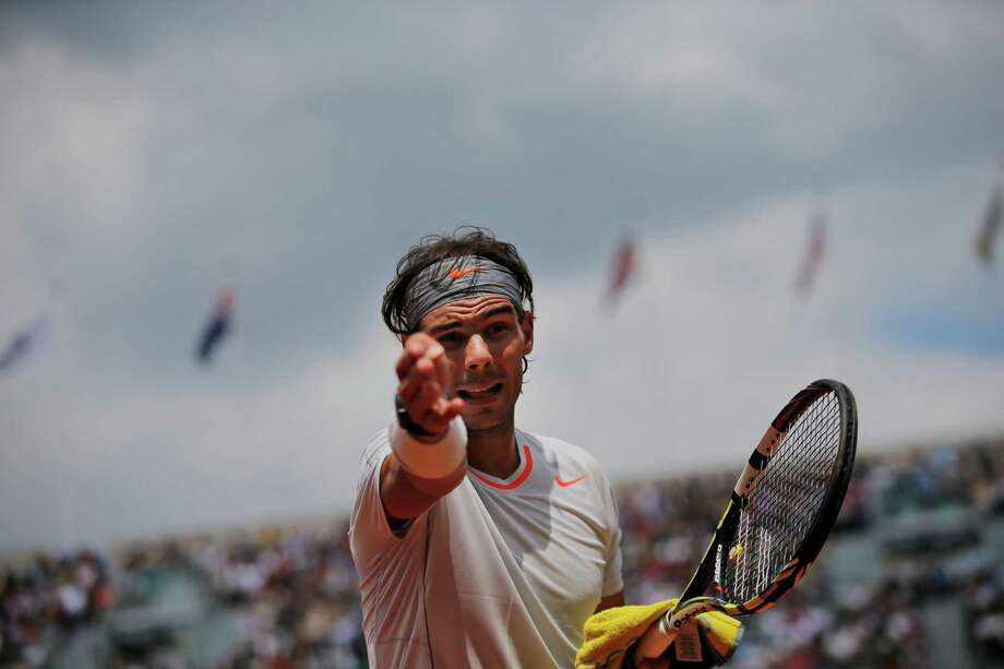 Spain's Rafael Nadal asks for the ball after it rolled into an underground press position in his first round match against Germany's Daniel Brands at the French Open tennis tournament at the Roland Garros stadium in Paris, Monday, May 27, 2013. Photo: Christophe Ena, AP / AP