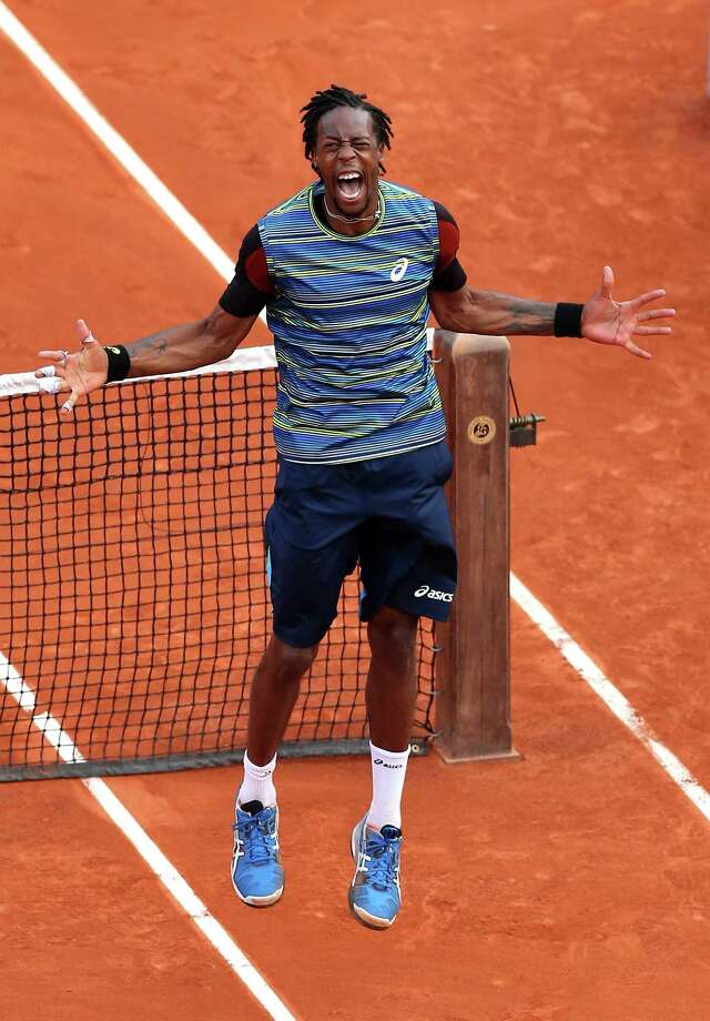 *** BESTPIX *** PARIS, FRANCE - MAY 27:  Gael Monfils of France celebrates match point in his Men's Singles match against Tonas Berdych of Czech Republic during day two of the French Open at Roland Garros on May 27, 2013 in Paris, France. Photo: Matthew Stockman, Getty Images / 2013 Getty Images