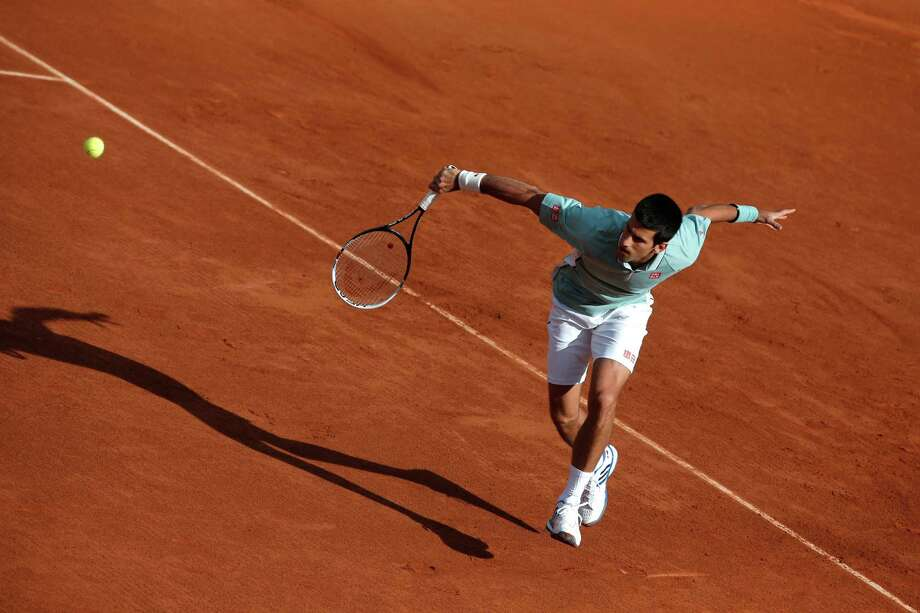 Serbia's Novak Djokovic returns against David Goffin of Belgium during their first round match at the French Open tennis tournament, at Roland Garros stadium in Paris, Tuesday, May 28, 2013. Photo: Michel Spingler, AP / AP