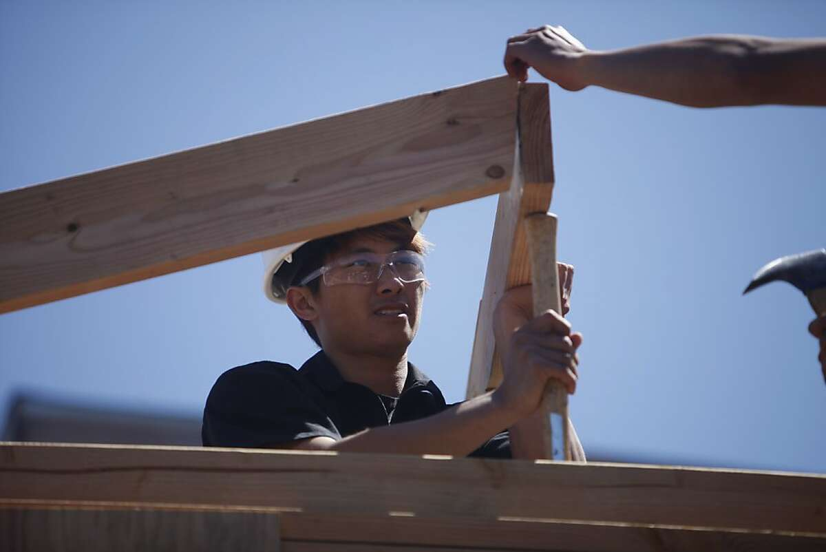 Barry Wu works on framing during a class with CityBuild Academy at the City College of San Francisco Evans Campus on Monday, April 15, 2013 in San Francisco, Calif.
