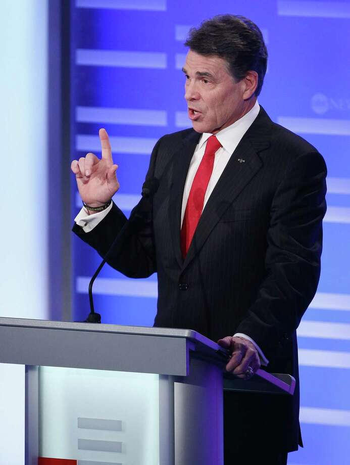 Rick Perry participates in the ABC News, Yahoo! News, and WMUR Republican Presidential Debate at Saint Anselm College January 7, 2012 in Manchester, N.H. Photo: Win McNamee, Getty Images / 2012 Getty Images