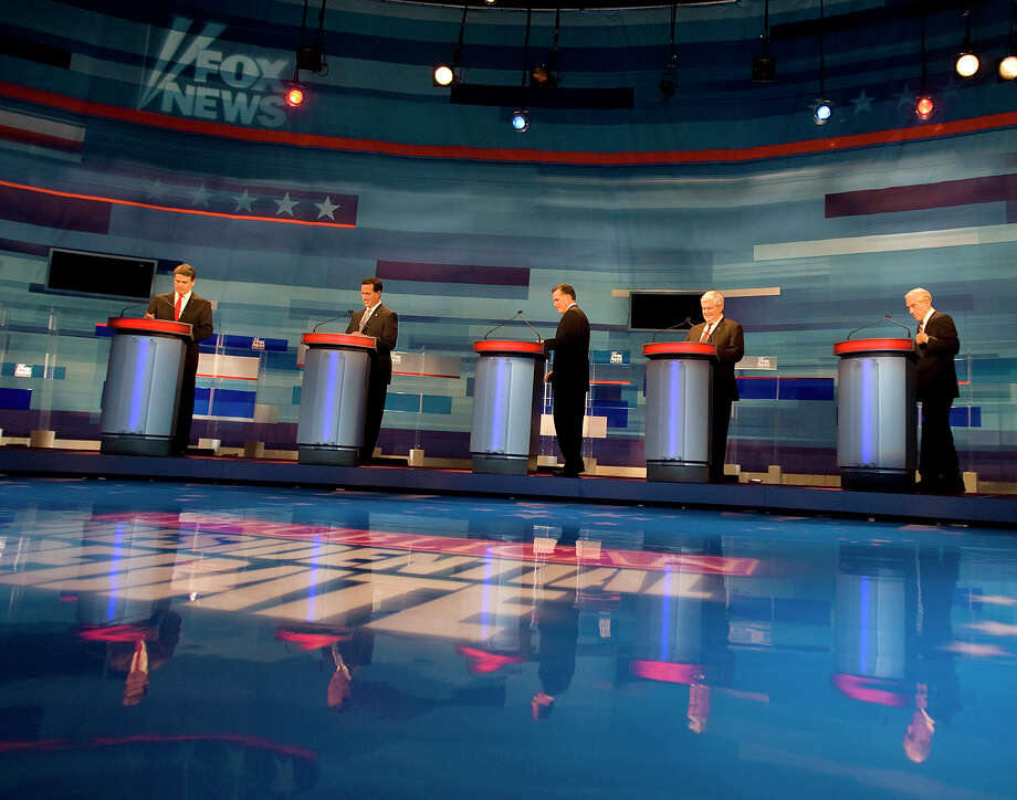Rick Perry, Rick Santorum, Mitt Romney, Newt Gingrich and Ron Paul take the stage for the Fox News debate at the Myrtle Beach Convention Center on Monday, Jan. 16, 2012 in Myrtle Beach, S.C. Photo: Janet Blackmon Morgan, Associated Press / ©The Sun News 2011