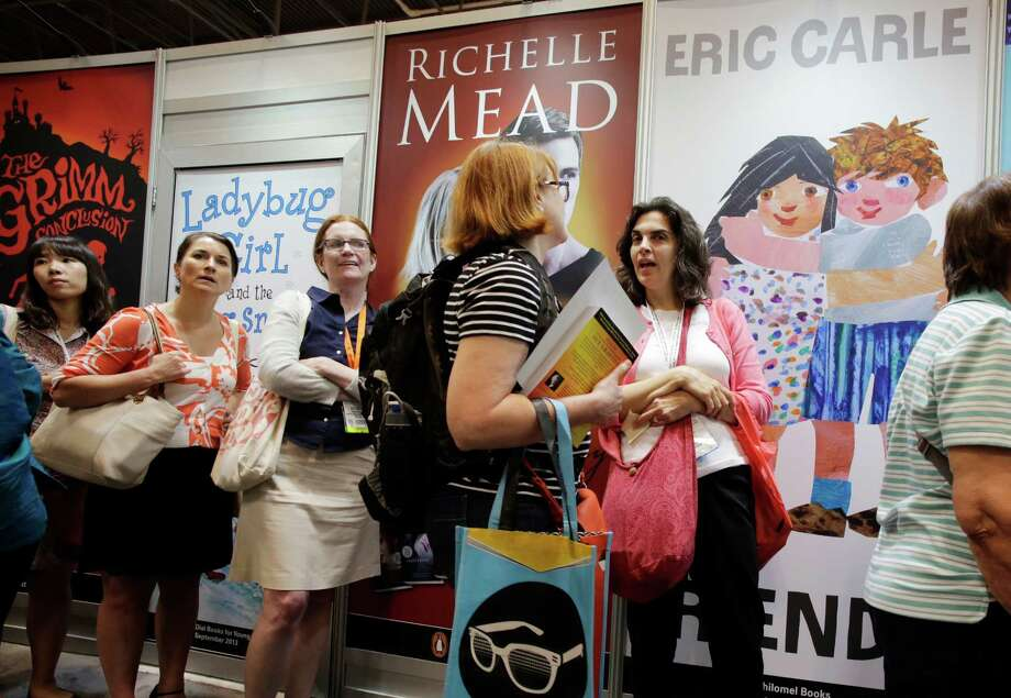 People wait in line to have books autographed by their authors at Book Expo America, Thursday, May 30, 2013 in New York. (AP Photo/Mark Lennihan) Photo: Mark Lennihan / AP
