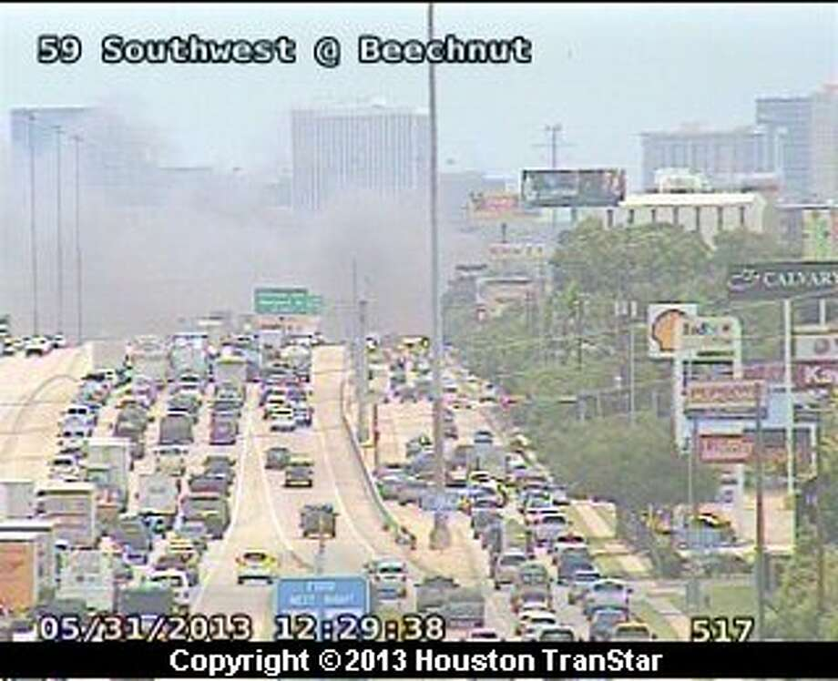 Firefighters battled a 4-alarm blaze along the Southwest Freeway near Hillcroft about noon Friday. Photo: Houston Transtar