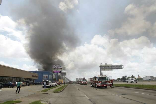 A fire caused the the Southwest Freeway to be shut down Friday afternoon. (Cody Duty / Houston Chronicle Photo: Cody Duty / Houston Chronic