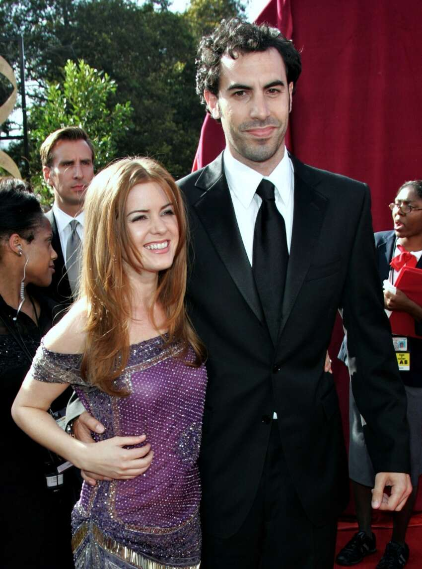 Sacha Baron Cohen (Jewish) and Isla Fisher (no faith) Although his famous character 'Borat' is anti-Semitic, Baron Cohen is a practicing Jew, and Fisher converted to Judaism years before the two married in 2010.
