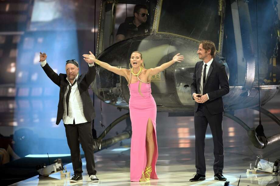 "MANNHEIM, GERMANY - MAY 30: Model Heidi Klum, Enrique Badulescu (r.) and Thomas Hayo (l.) reacts during the final of 'Germany's Next Top Model' TV show at SAP Arena on May 30, 2013 in Mannheim, Germany. The four finalist Sabrina Elsner, Luise Will, Lovelyn Enebechi and Maike van Grieken fight under the motto  ""Closer than ever"" for the top model crown.  (Photo by Thomas Lohnes/Getty Images)"