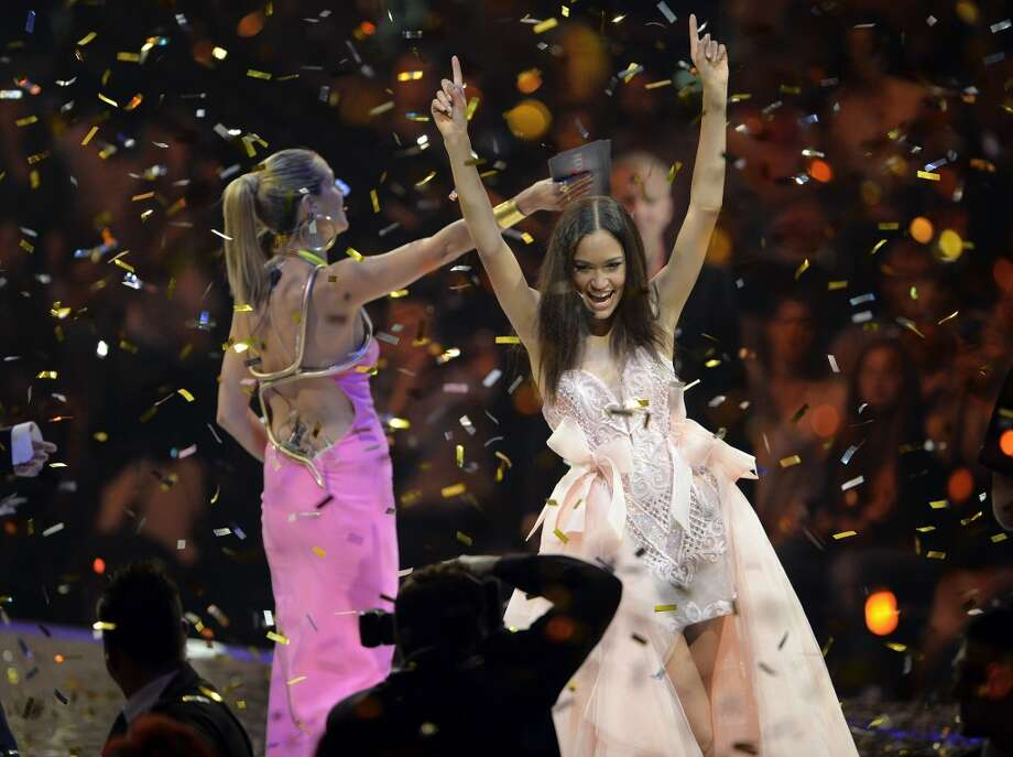 MANNHEIM, GERMANY - MAY 30:  Lovelyn Enebechi (r) celebrates after winning the final of 'Germany's Next Top Model by Heidi Klum ' TV show at SAP Arena on May 30, 2013 in Mannheim, Germany.  (Photo by Thomas Lohnes/Getty Images)
