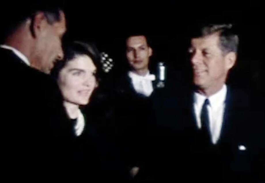 This frame grab provided Feb. 22, 2011, by the The Sixth Floor Museum at Dealey Plaza in Dallas shows an image of President John F. Kennedy and first lady Jacqueline Kennedy on the eve of his 1963 assassination. The silent film shows the Kennedy's during their appearance at a League of United Latin American Citizens at the Rice Hotel in Houston on the night of Nov. 21, 1963. Roy Botello of San Antonio, who shot the film with his home movie camera, has donated the film to the museum. (AP Photo/The Sixth Floor Museum at Dealey Plaza) NO SALES, NO ARCHIVE, ONE TIME USE Photo: AP / The Sixth Floor Museum at Dealey