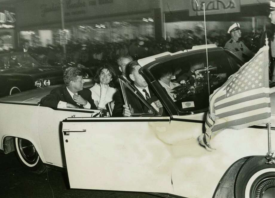 11/21/1963: Hundreds lined the sidewalks on Main Street and Texas Avenue as President  John F. Kennedy's motorcade reached the Rice Hotel. Photo: © Houston Chronicle / Houston Post Files