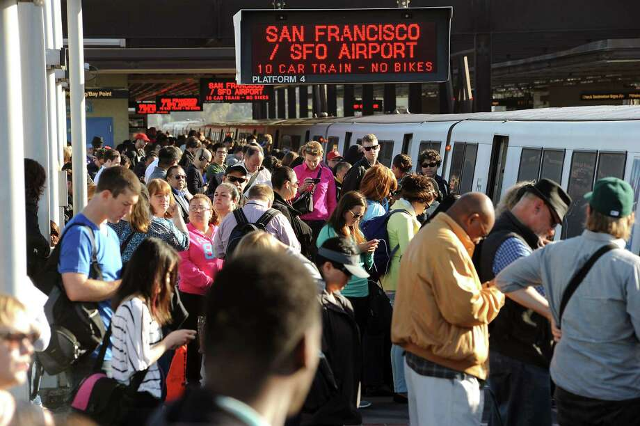 Crowds of commuters wait to board San Francisco bound trains at the MacArthur BART station in Oakland, CA on Friday May 31st, 2013. BART is experiencing severe delays while trains are running single track after two maintenance vehicles collided in the transbay tube, resulting in track damage needing repair. Photo: Michael Short / Special To The Chronicle / ONLINE_YES
