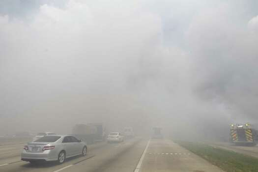 Smoke covered U.S. 59 after a massive fire Friday afternoon. (Cody Duty / Houston Chronicle) Photo:  (Cody Duty / Houston Chronicle)