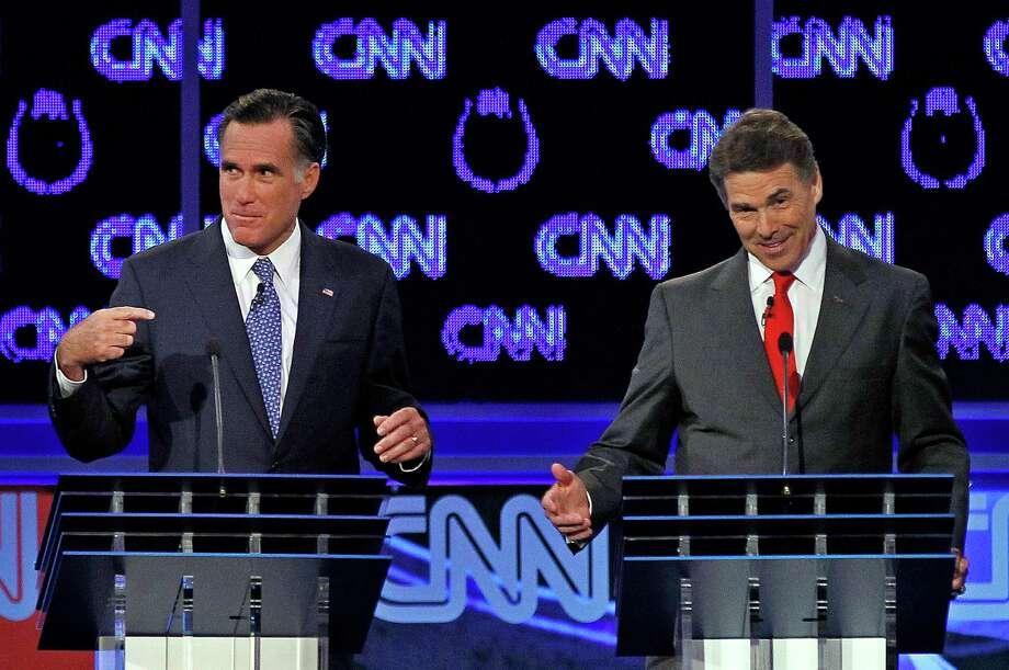 Mitt Romney and Rick Perry spar during a Republican presidential debate in Las Vegas. Photo: Chris Carlson, Associated Press / AP