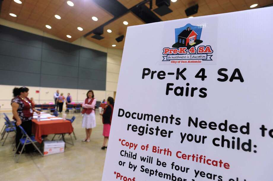 "Parents and teachers met during a recent Pre-K 4 SA fair at a South San Antonio Independent School District site. A reader calls the $23 million price tag ""exorbitant."" Photo: Billy Calzada, San Antonio Express-News / San Antonio Express-News"