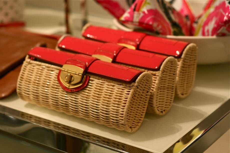 Wicker and coral patent clutches.