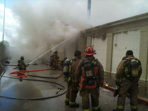 Fire fighters on the scene. Photo: Houston Chronicle