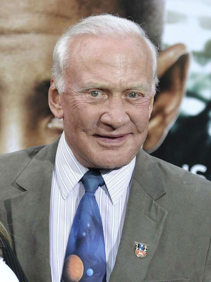"This May 29, 2013 photo shows former astronaut Buzz Aldrin at the ""After Earth"" premiere at the Ziegfeld Theatre in New York. (Photo by Evan Agostini/Invision/AP) Photo: Evan Agostini"