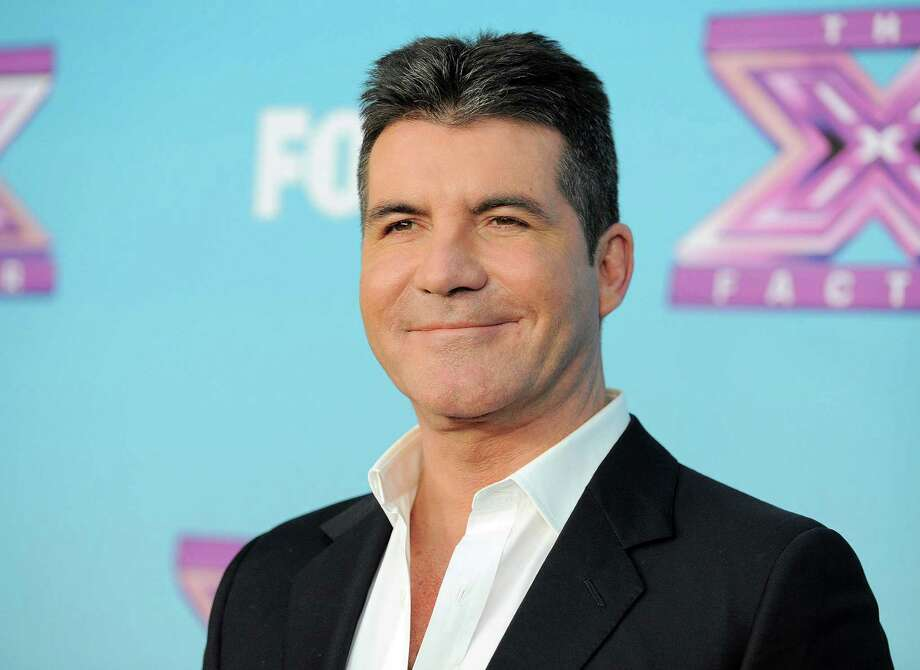 "FILE - This Dec. 20, 2012 file photo shows Simon Cowell at the ""The X Factor"" season finale results show at CBS Television City in Los Angeles. The new season of ""America's Got Talent"" starts Tuesday at 9 p.m. EDT. New judges include former Spice Girl Mel B. and supermodel/personality Heidi Klum joining forces with Howie Mandel and Howard Stern. (Photo by Jordan Strauss/Invision/AP, file) Photo: Jordan Strauss"