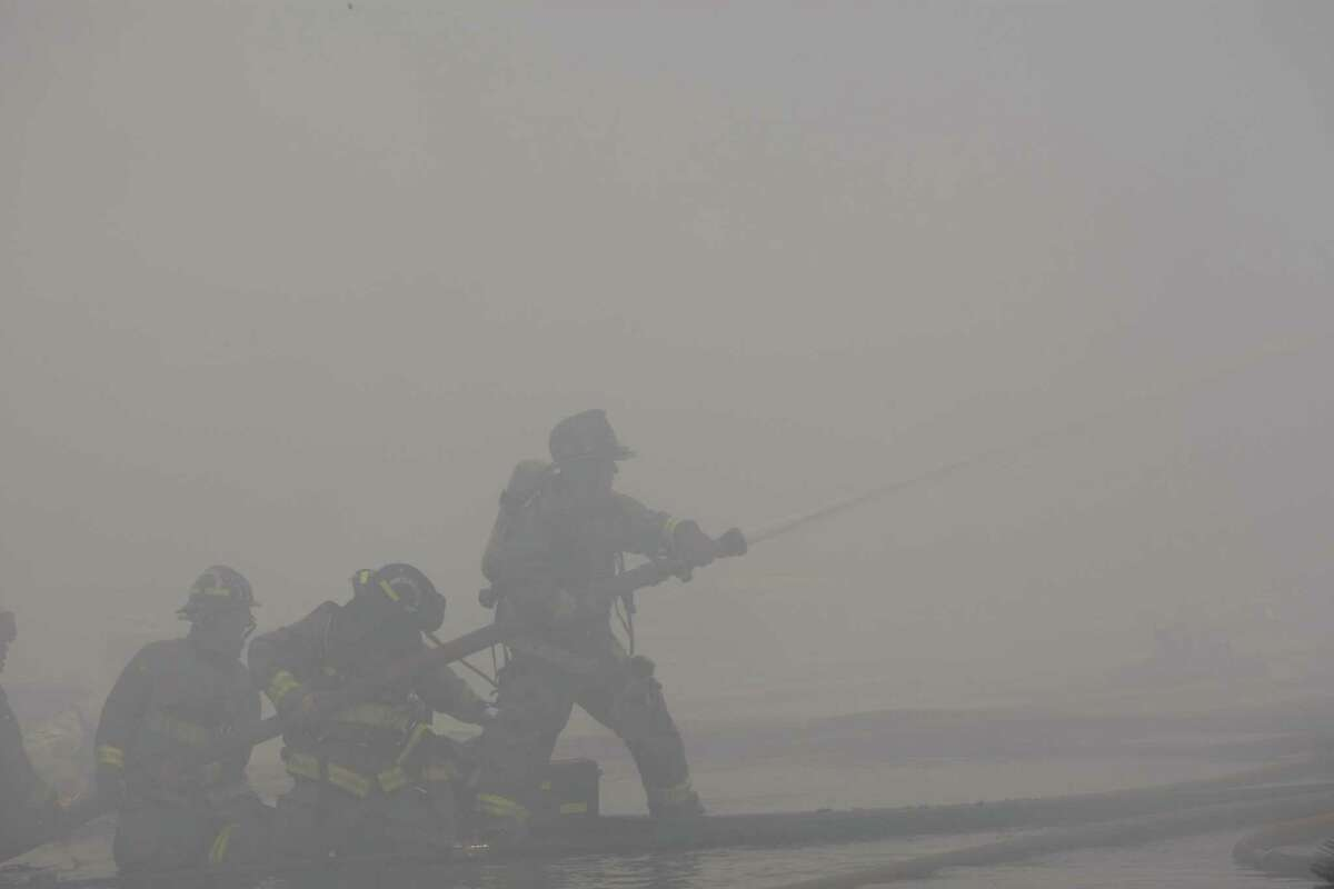Fire fighters battle the fire.