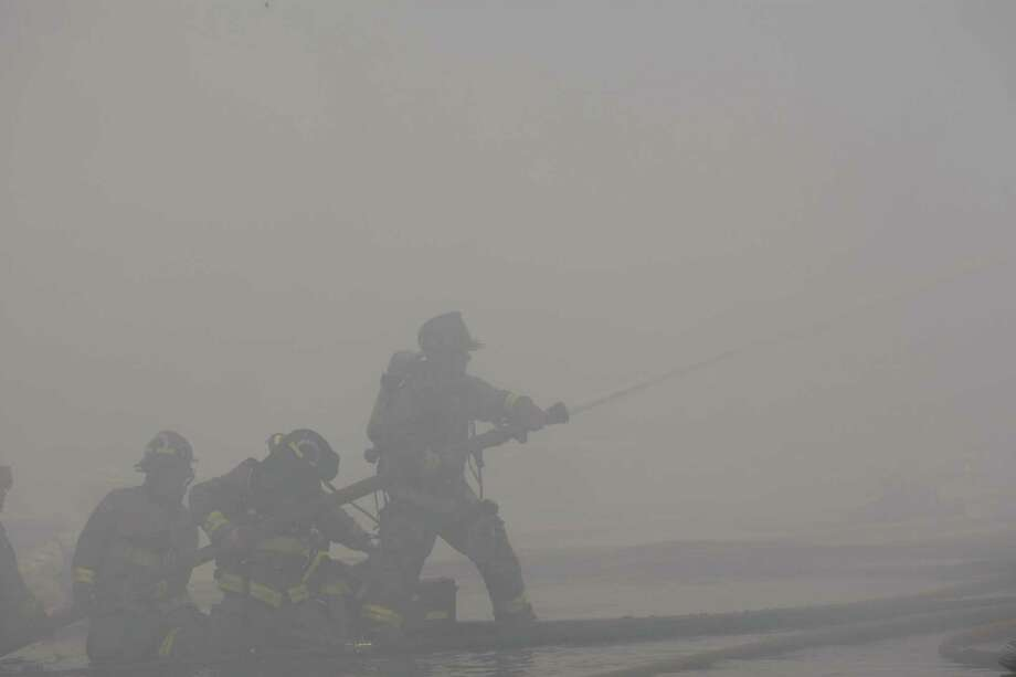 Fire fighters battle the fire. Photo: Cody Duty/ Houston Chronicle