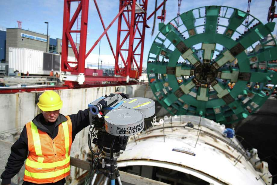 An IMAX film crew works as the cutter head of the Washington State Department of Transportation's Big Bertha Highway 99 tunnel boring machine is lowered into its launch pit on Friday, May 31, 2013. The machine is scheduled to be launched in July and will emerge from the other end of the tunnel 14 months later. Photo: JOSHUA TRUJILLO, SEATTLEPI.COM / SEATTLEPI.COM
