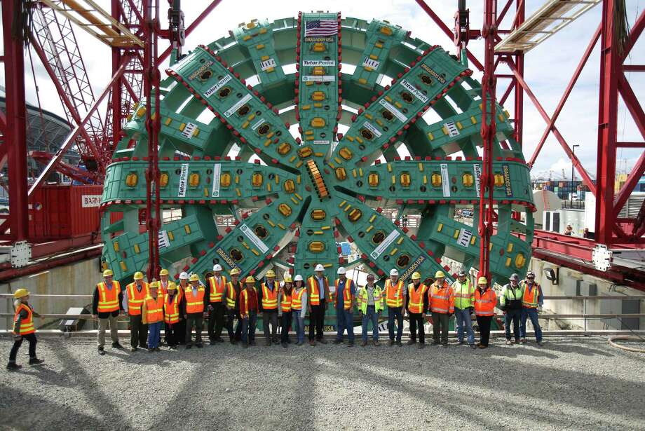Workers and officials pose for a photo as the cutter head of the Washington State Department of Transportation's Big Bertha Highway 99 tunnel boring machine is lowered into its launch pit on Friday, May 31, 2013. Photo: JOSHUA TRUJILLO, SEATTLEPI.COM / SEATTLEPI.COM