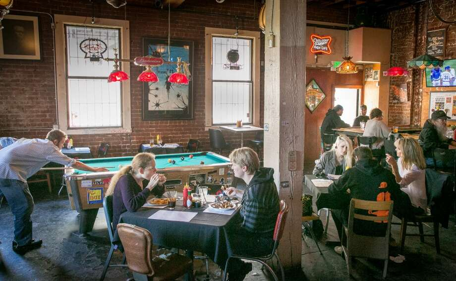 People have lunch at Box Kitchen inside of the Tempest Bar in San Francisco.