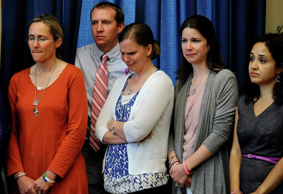 Scarlett Lewis, left, mother of Sandy Hook School shooting victim Jesse Lewis, Robbie and Alissa Parker, parents of victim Emilie Parker, left center, Krista Rekos, right center, mother of victim Jessica Rekos, and Nelba Marquez-Greene, mother of victim Ana Marquez-Greene, right, listen during a news conference at the Capitol in Hartford, Conn., Friday, May 31, 2013. Family members of the school shooting victims are making a last-minute appearance at the state Capitol to urge Connecticut legislators to pass a bill that would block the public release of crime scene photos and other records from the massacre.