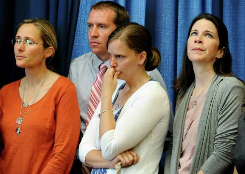 Scarlett Lewis, left, mother of Sandy Hook School shooting victim Jesse Lewis, left, Robbie and Alissa Parker, parents of victim Emilie Parker, center, and Krista Rekos, right, mother of victim Jessica Rekos, listen during a news conference at the Capitol in Hartford, Conn., Friday, May 31, 2013.  Family members of the school shooting victims are making a last-minute appearance at the state Capitol to urge Connecticut legislators to pass a bill that would block the public release of crime scene photos and other records from the massacre. Photo: Jessica Hill, AP Photo/Jessica Hill / AP2013 Associated Press