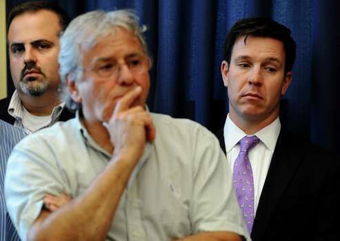 Mark Mattioli, left, father of Sandy Hook School shooting victim James Mattioli, Gilles Rousseau, center, father of victim Lauren Rousseau, and Brian Engel, father of victim Olivia Engel, right, listen during a news conference at the Capitol in Hartford, Conn., Friday, May 31, 2013.  Family members of the school shooting victims are making a last-minute appearance at the state Capitol to urge Connecticut legislators to pass a bill that would block the public release of crime scene photos and other records from the massacre. Photo: Jessica Hill, AP Photo/Jessica Hill / AP2013 Associated Press