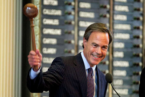 Speaker of the House Joe Straus, R-San Antonio, smiles as he bangs the gavel closing Sine Die on the 83rd Legislator held at the State Capitol on Monday, May 27, 2013, in Austin, Texas. Soon after the closing of the 83rd Legislator Governor Rick Perry called for a special session to begin immediately to consider  redistricting. (AP Photo/Austin American-Statesman, Rodolfo Gonzalez)