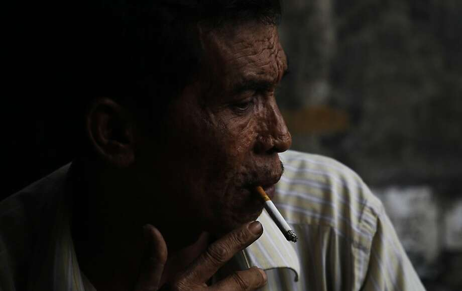 Hooked in Jakarta: Of every three men in Indonesia, two are smokers -  tops in the world percentage-wise. May 31 is World No Tobacco Day. Photo: Achmad Ibrahim, Associated Press