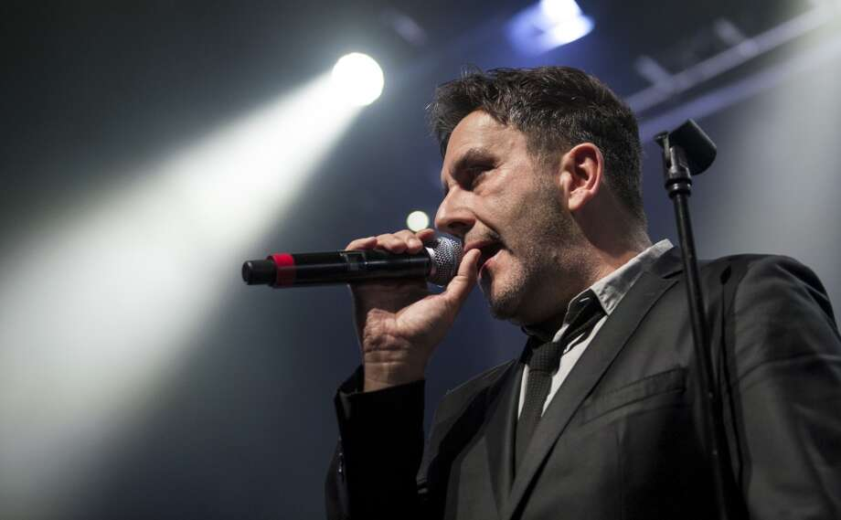Terry Hall of The Specials performs on stage at Portsmouth Guildhall, England on May 26, 2013. The band stops at Ives Concert Park in Danbury on Tuesday, July 16.