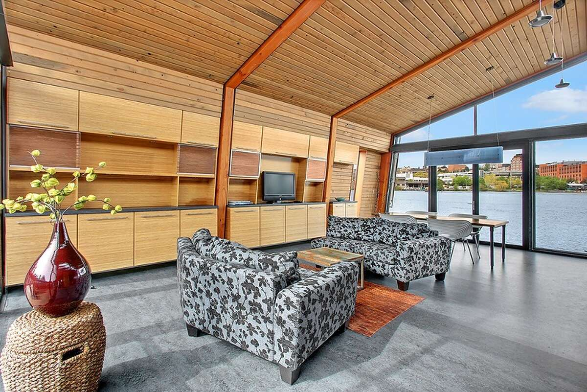 Living room of 3130 Portage Bay Place E., Unit D. The 1,000-square-foot floating home, built in 2010, has one bedroom, a three-quarter bathroom, floor-to-ceiling windows, vaulted ceilings, cedar finishes, heated Marmoleum floors, a 500-square-foot roof deck and 40 feet of waterfront. It's listed for $1.25 million.