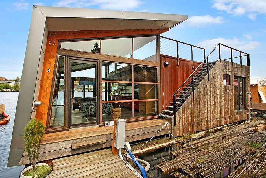 This week, the real estate spotlight turns to the water, focusing on 3130 Portage Bay Place E., Unit D. The 1,000-square-foot floading home, built in 2010, has one bedroom, a three-quarter bathroom, floor-to-ceiling windows, vaulted ceilings, cedar finishes, heated Marmoleum floors, a 500-square-foot roof deck and 40 feet of waterfront. It's listed for $1.25 million. Photo: Vista Estate Imaging,  Courtesy Louis Herrera,  RT Brokerage Services