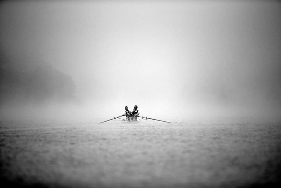 Oarer show: Hamish Bond and Eric Murray of the Elite Mens Pair row through a spooky fog during the Winter Series regatta in Cambridge, New Zealand. Photo: Phil Walter, Getty Images