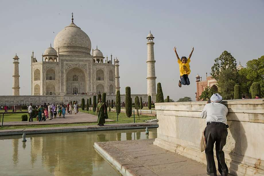 A Taj Mahal photo op has an Indian girl jumping for joy in Agra. Photo: Daniel Berehulak, Getty Images